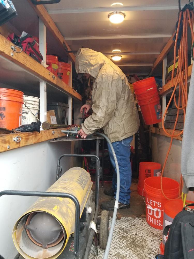 REI Technicians Repairing Compactor