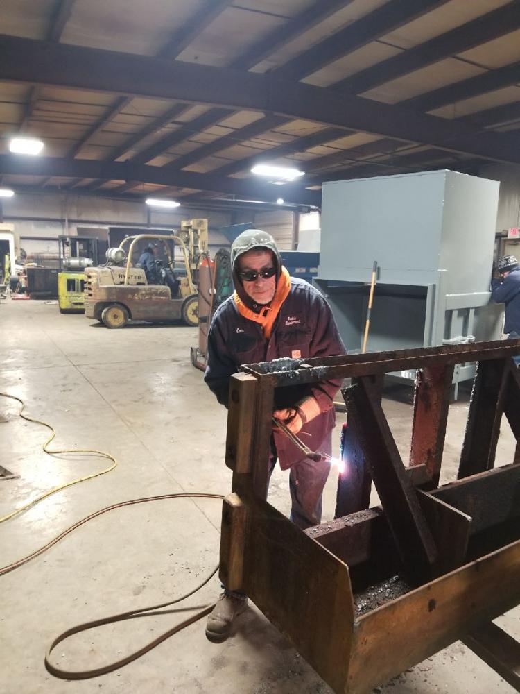 REI Technicians Repairing Dumper